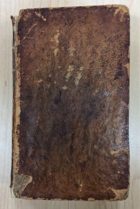 "A very worn front cover of Jefferson's ""Notes on the State of Virginia"""